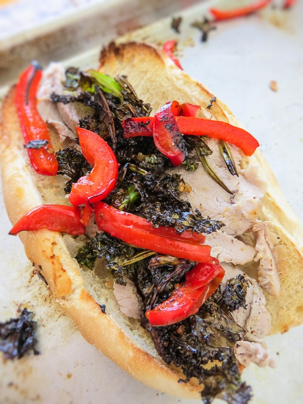 Porchetta Sandwiches - Easy to make sheet pan main dish meal. Pork tenderloin, rapini (broccoli rabe), peppers and onions are all cooked on one baking sheet! Great for small to large gatherings, lunch or supper/dinner and for packed lunches! Plus you're gonna love the easy clean up!