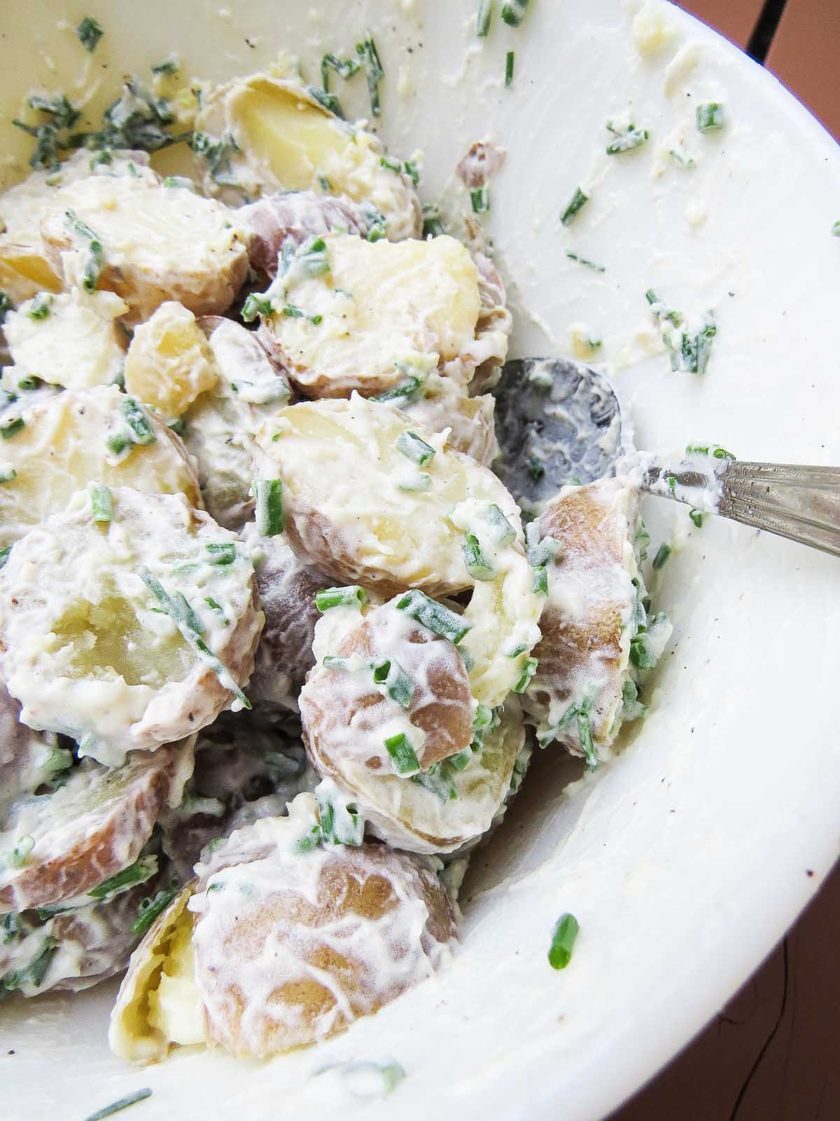 Rustic Potato Salad - Don't bother with removing the potato skins in this Rustic Potato Salad recipe! Keeping them on and adding home grown chives from the garden gives this recipe a rustic feel! Plus it is a perfect recipe for a picnic or packed in the cooler for camping!