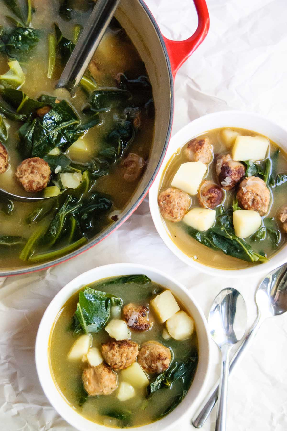 Hearty sausages, potatoes and collard greens are here to fill you up and warm your soul in this PortugueseCaldo Verde Soup recipe! One pot, easy to make and great as leftovers for the week!
