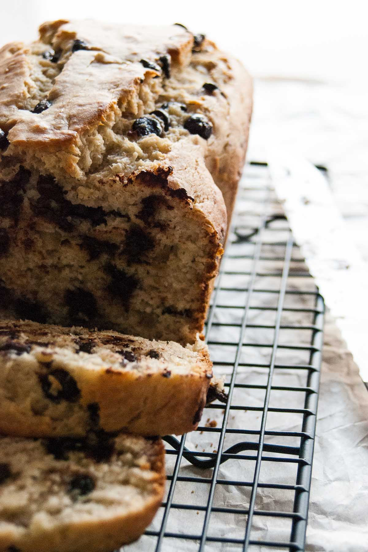 Chocolatey goodness, creamy buttermilk and ripe bananas are what make this Chocolate Chip Buttermilk Banana Bread recipe the envy of the sweet snack world! - thebeaderchef.com
