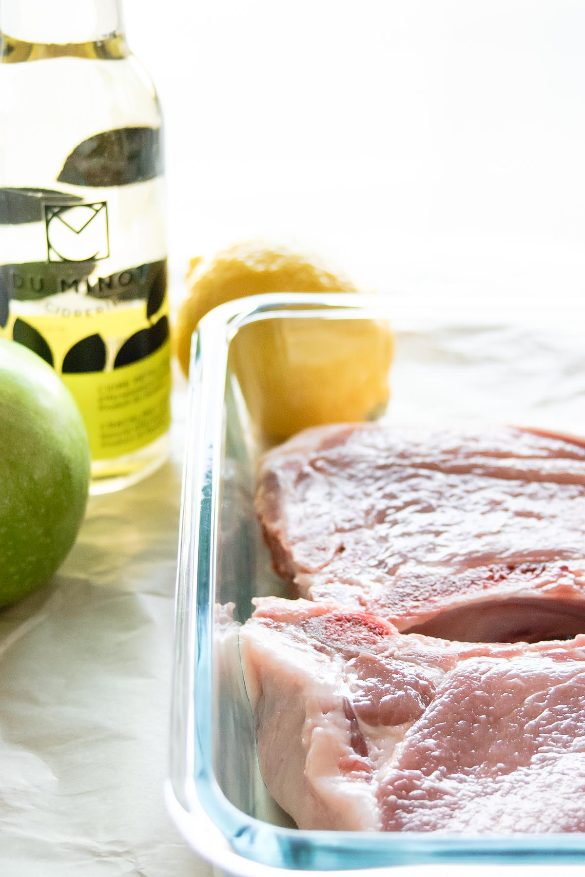 This Juicy Lemon Apple Cider Pork Chops recipe is the bomb-diggity! They feature a tangy citrus flavor with the sweetness of apple cider, perfect for fall! - thebeaderchef.com Pork | Apple | Main Dish | Juicy | Easy | Cider | Fall | Autumn | Cooking for Two | Gluten-Free | Dairy-Free