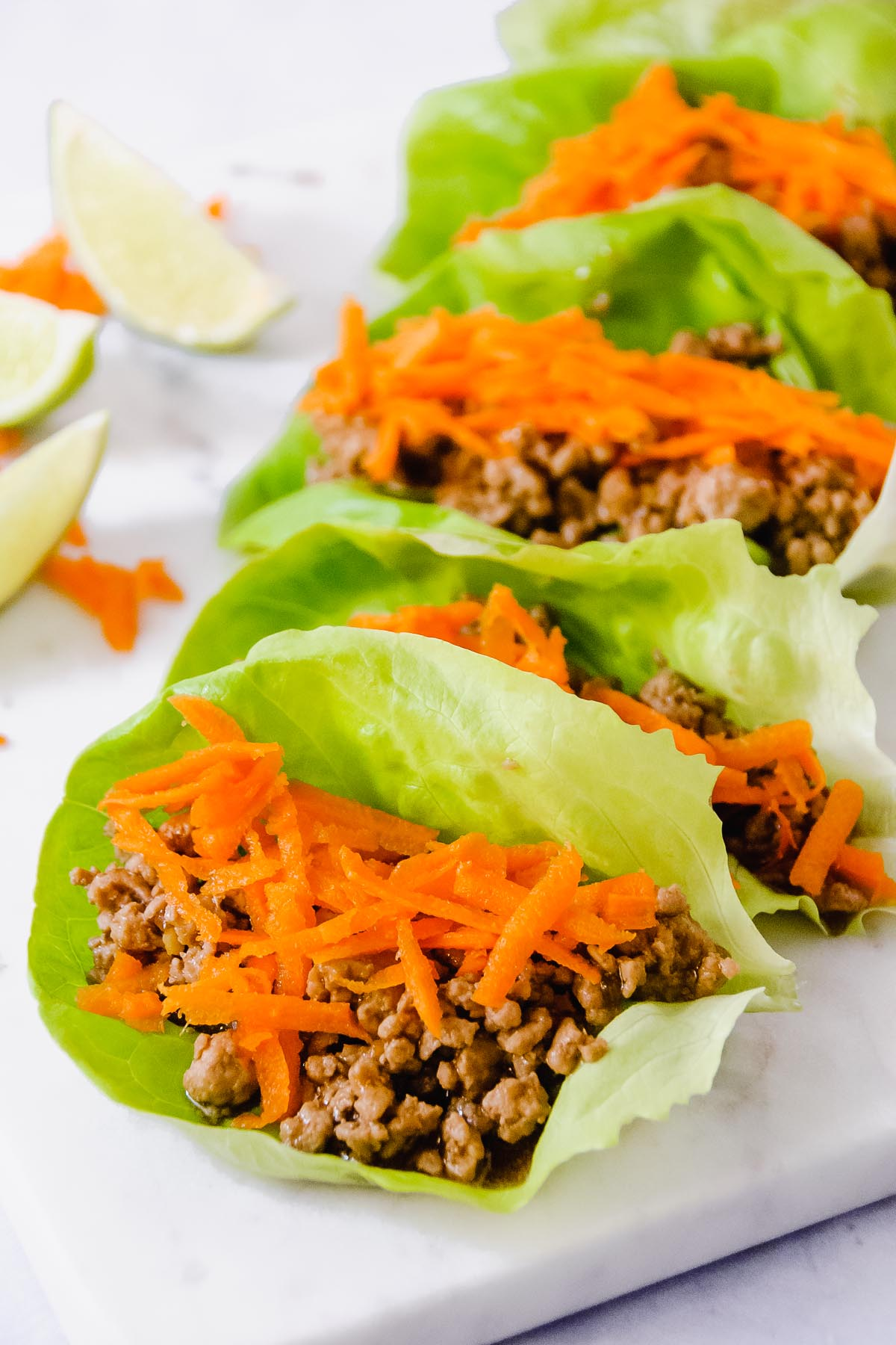 Spicy Garlic Pork Lettuce wraps are the answer to a quick - 30 minute and it's ready - weeknight meal for two… or more! Plus, even if you are just two, it's fun to build your meal together at the table! - thebeaderchef.com #30minutemeals #weeknight #quick #lettucewraps #cookingfortwo