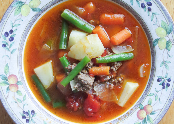 Beef & Vegetable Soup - This beef and vegetable soup is sure to become one of your weekday work horses: taking only 30 minutes to make and adaptable to ingredients on hand.
