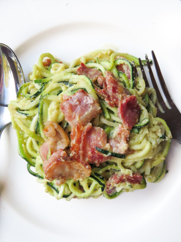 A plate with classic carbonara with zucchini noodles.