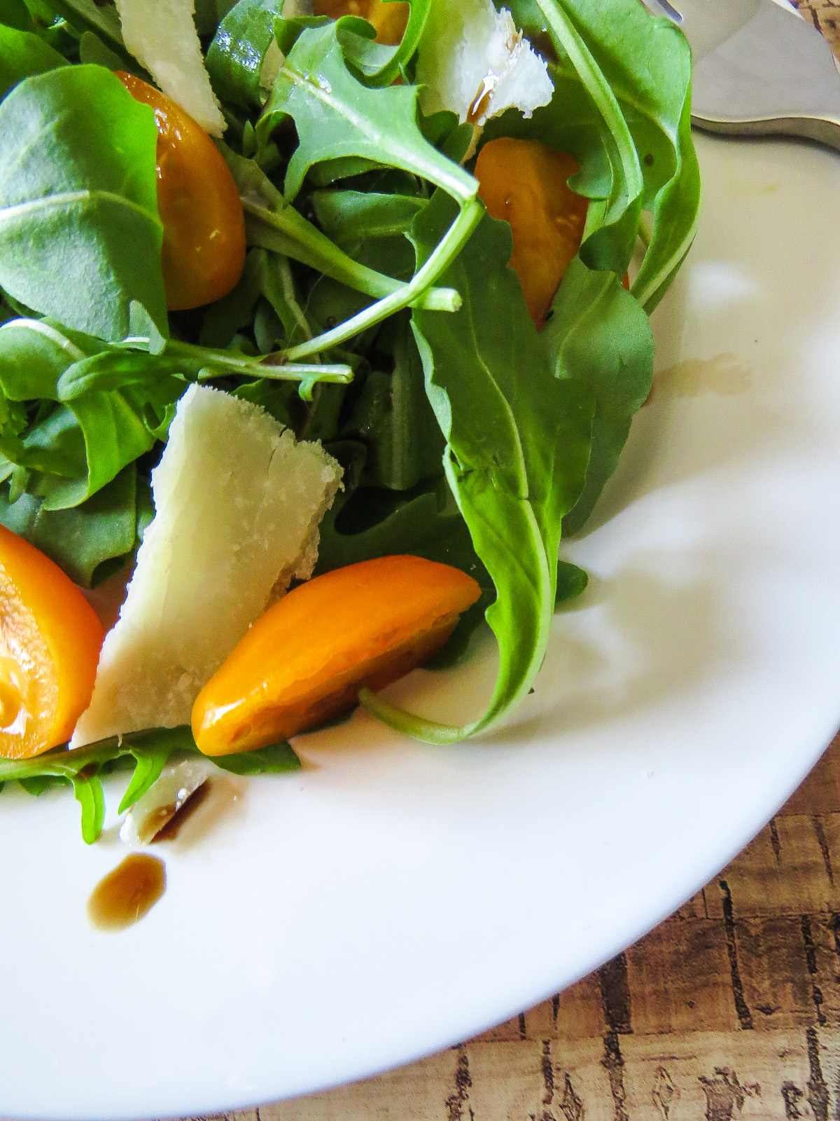 Arugula Salad with Balsamic Vinaigrette - Magic happens with arugula salad is drizzled with a balsamic vinaigrette, and its made even better with some additions!