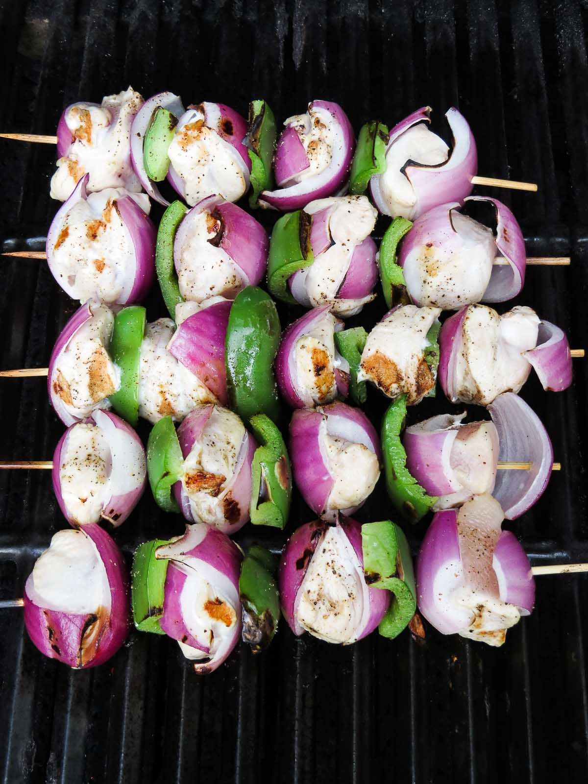 Grill Ready Vegetable & Chicken Skewers - Skip the costly store bought skewers and make your own Vegetable Chicken Skewers! Choose your favourite veggies, skewer them together with chicken, season and grill for an amazing main dish recipe great for two or many! Bonus points if you make extra and toss into a salad for lunch or a picnic the next day!