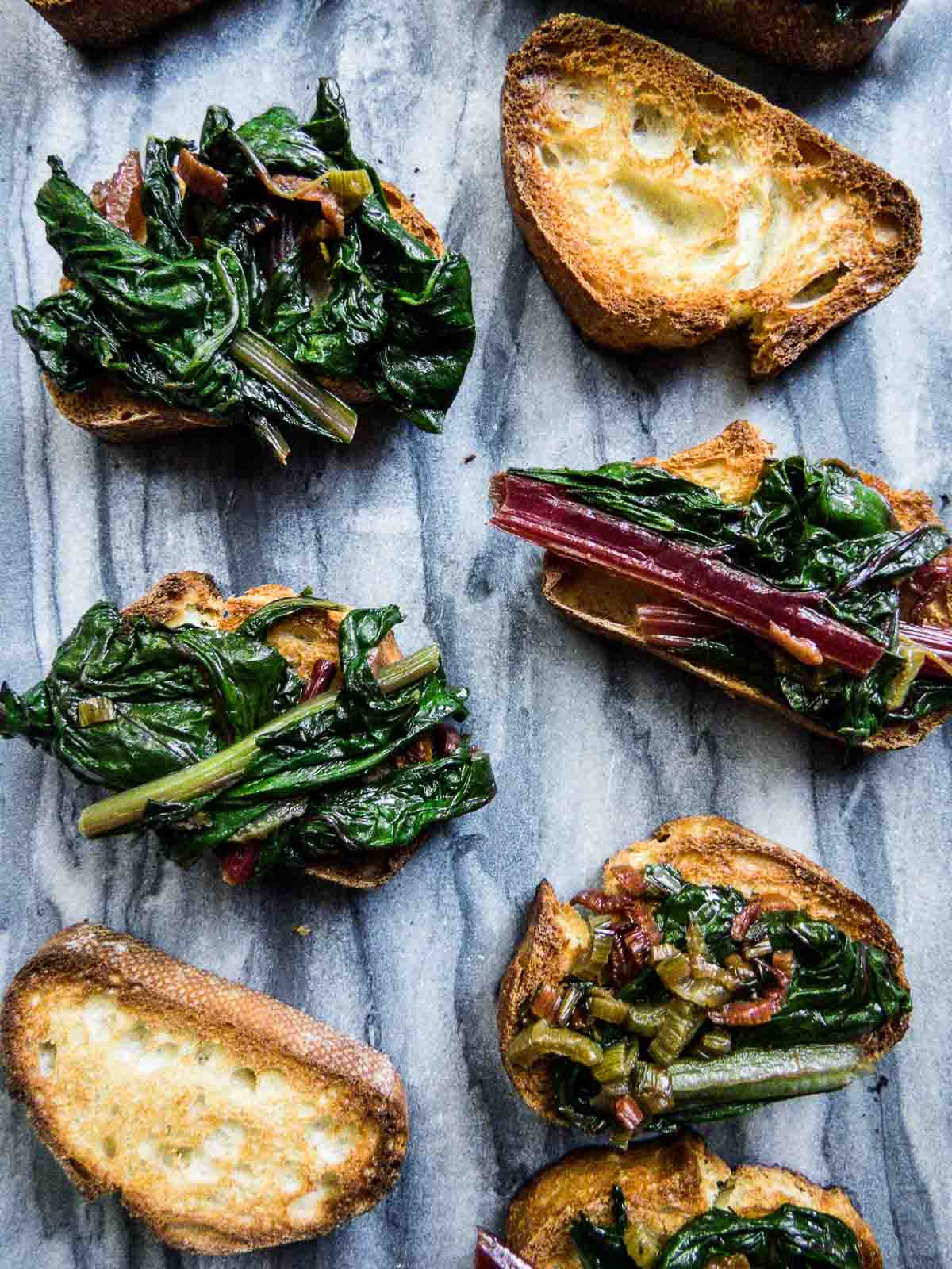 Nothing can get better than grilled or toasted bread topped with garden fresh garlicky Swiss chard. As an appetizer, savory snack or side, Garlicky Swiss Chard Bruschetta will be an easy and impressive addition to any menu!