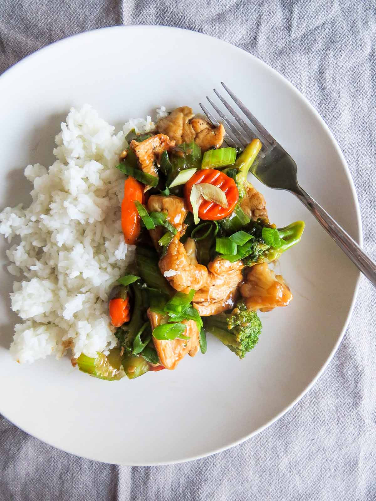Kitchen Sink Chinese Stir Fry to the RESCUE! Got fresh and frozen vegetables lying around that you don't know what to do with? This main dish recipe has got your back and is perfect for two, a couple or many!