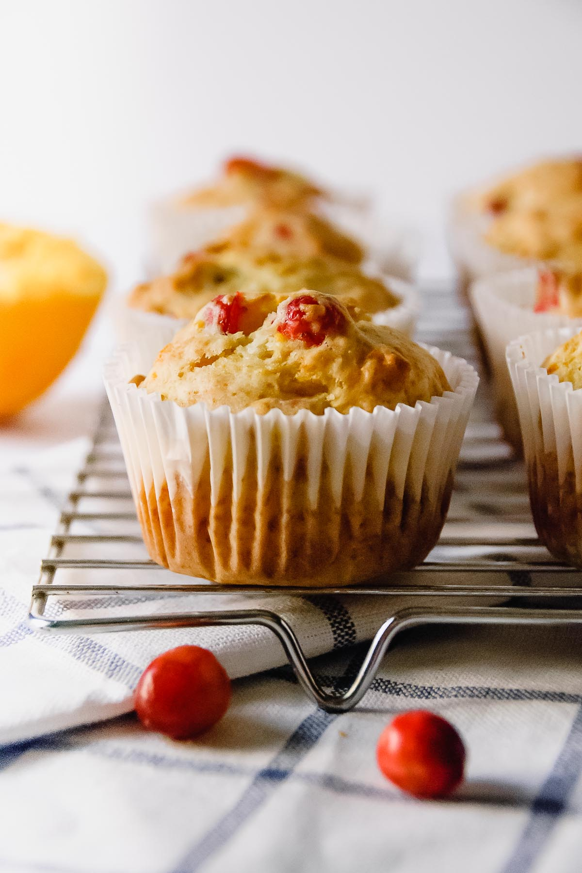 Tart, citrusy, and not too sweet… these No Fuss Cranberry Orange Muffins are the perfect seasonal make-ahead breakfast or snack that will keep you going through the Thanksgiving season all the way to Christmas! - thebeaderchef.com #cranberries #orange #muffins #christmasbreakfast #thanksgivingbreakfast #breakfast #snack #christmas #thanksgiving