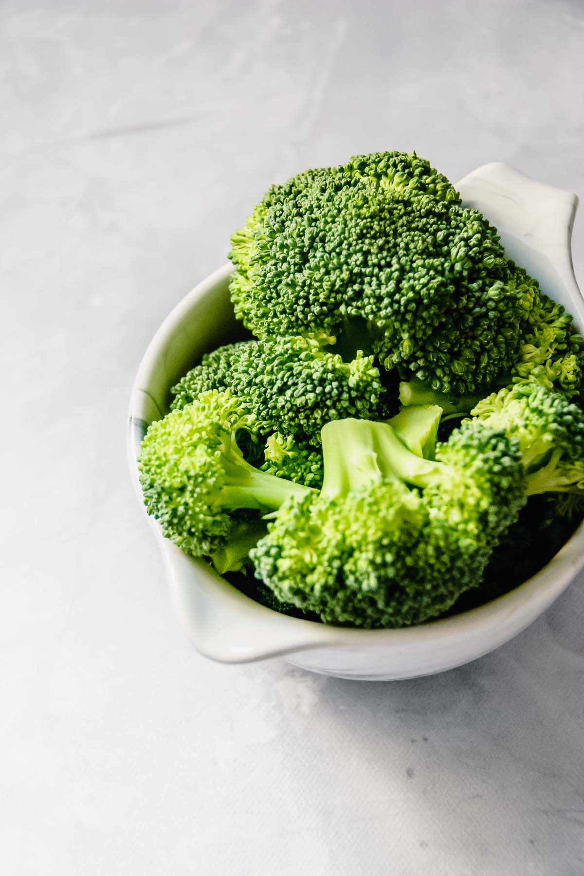 Broccoli in a marble prep bowl