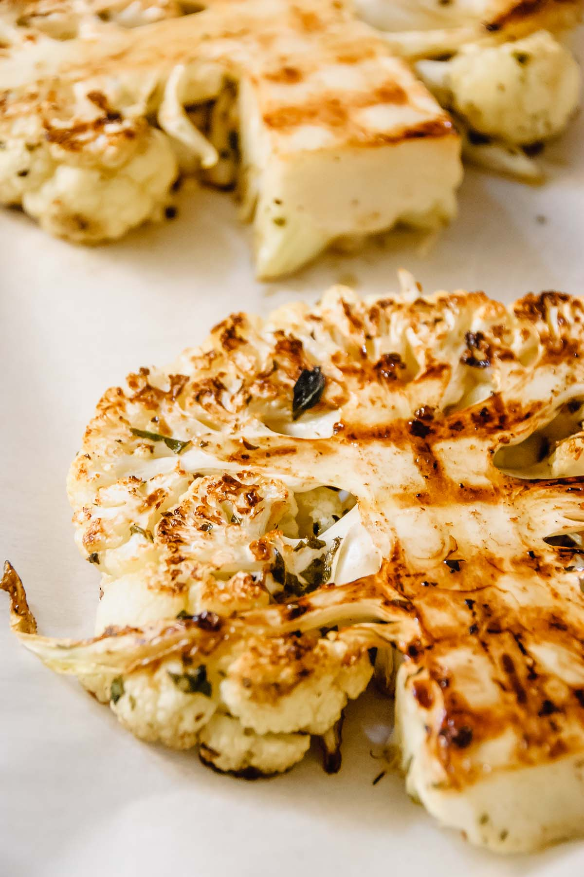 Close up of a grilled greek cauliflower steak.