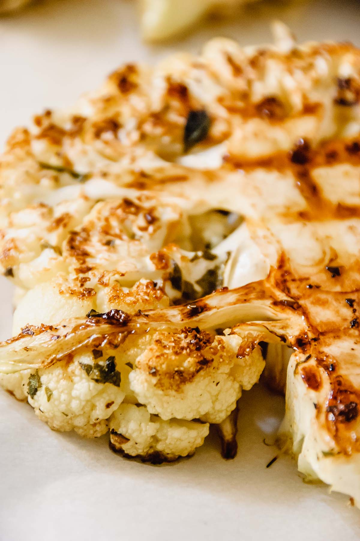 Super close up of a grilled greek cauliflower steak.