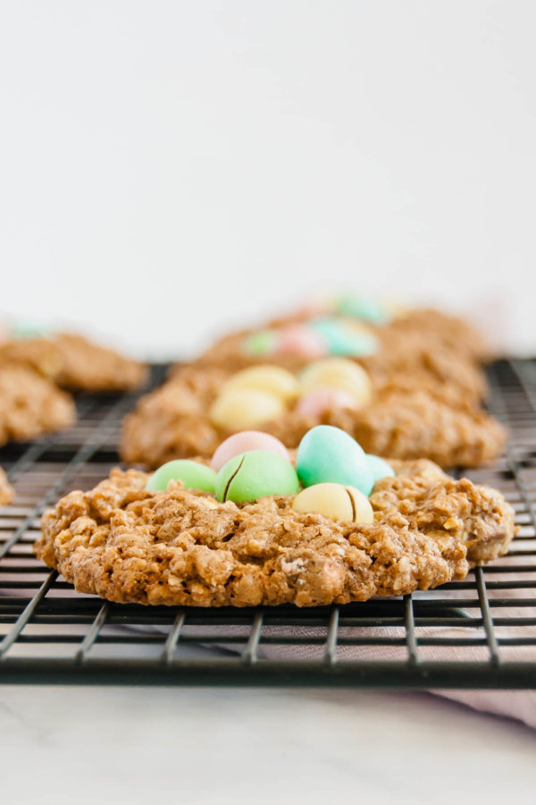Close up of small batch mini egg oatmeal cookies on a wire rack.