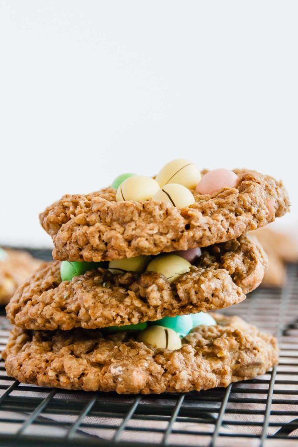 Stack of small batch mini egg oatmeal cookies on a wire rack.