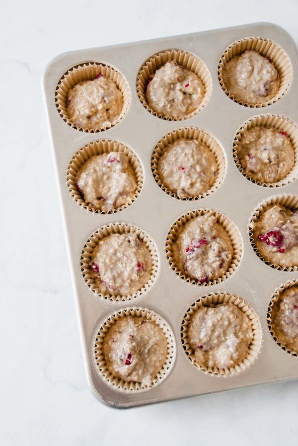 Lined muffin tin with the batter for the best oatmeal muffins ready to be baked.