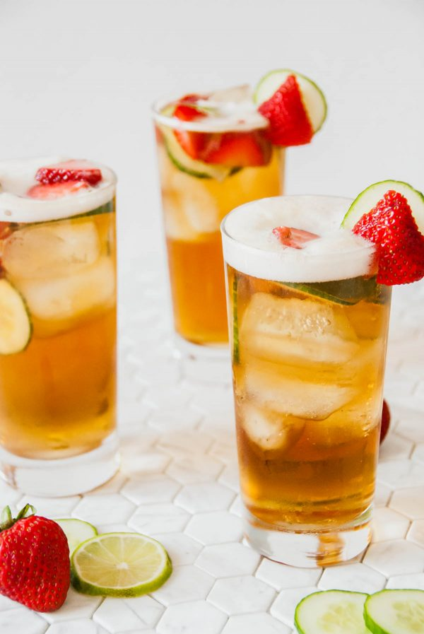 Three highball glasses of Pimm's cup.