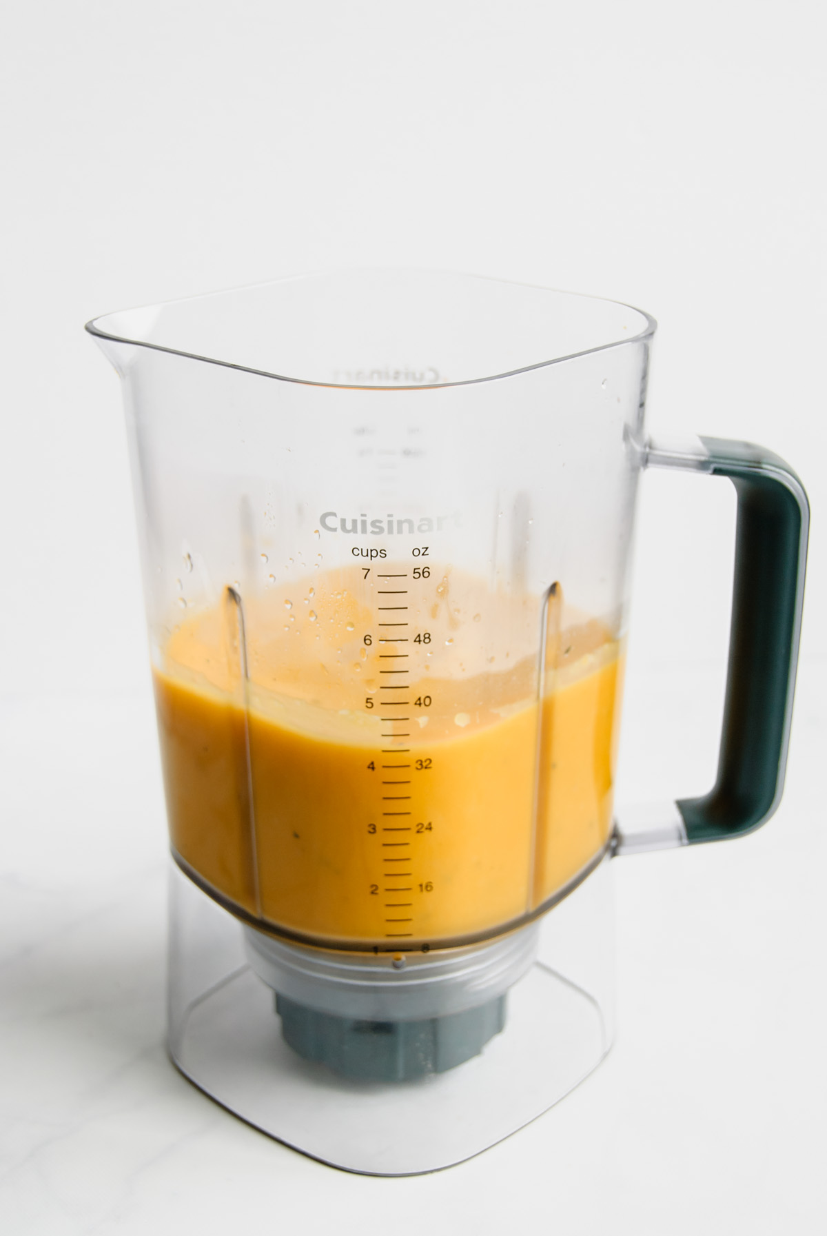 Blender full of pureed roasted butternut squash soup.