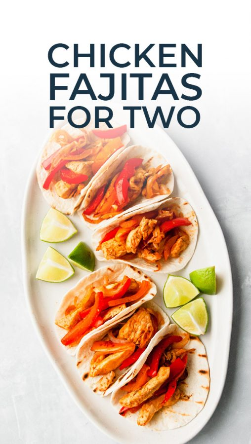A platter of chicken fajitas for two with recipe name on the photo for Pinterest.