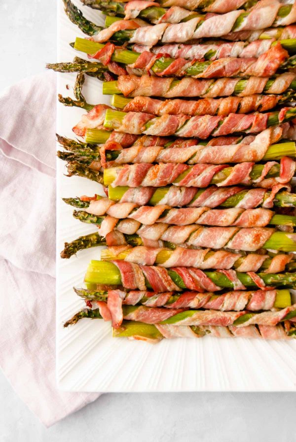 Close up of bacon-wrapped asparagus on a platter.