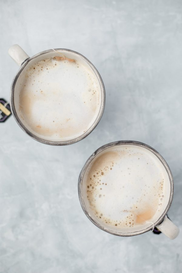 Top view of two mugs containing London fog latte for two.