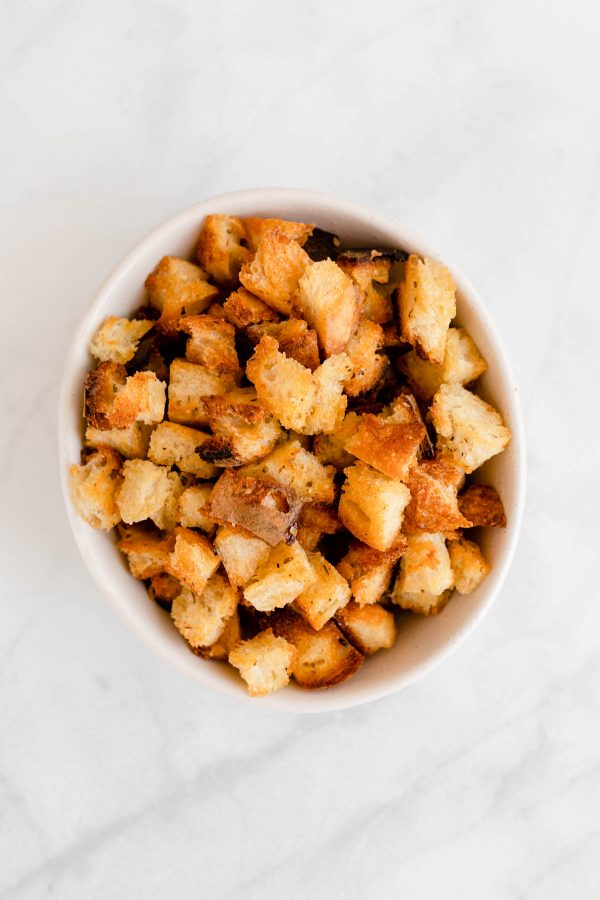 Top view of a bowl containing croutons.