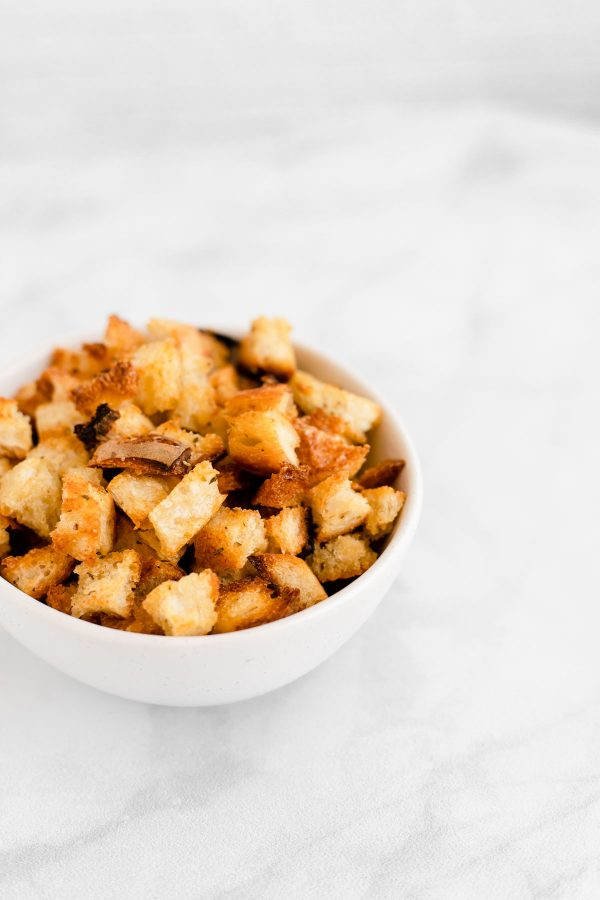 Side view of a bowl containing croutons.