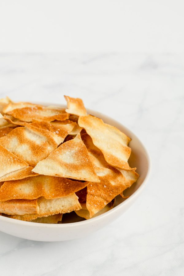 Side view of a large bowl of pita chips