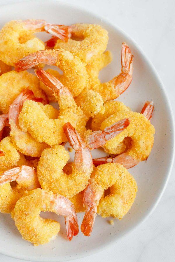 Top view close up of air fryer popcorn shrimp on a platter.