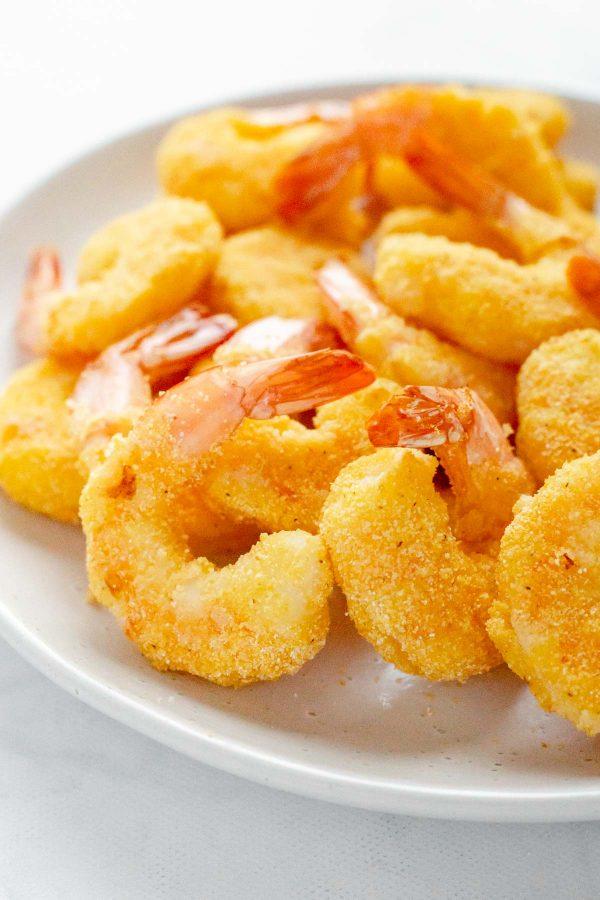 Side view close up of air fryer popcorn shrimp on a platter.
