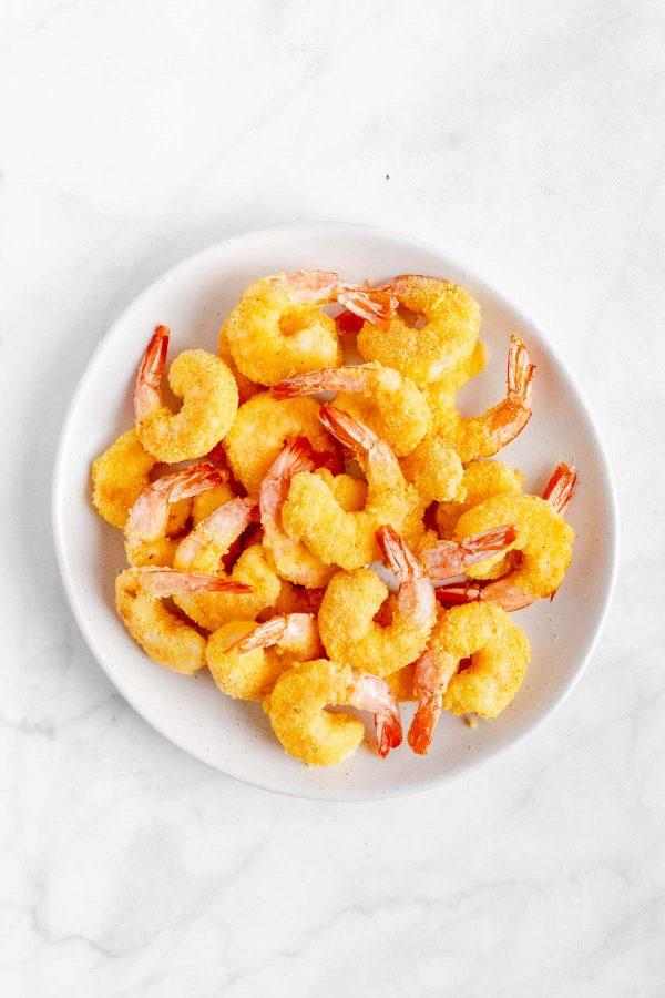 Top view of air fryer popcorn shrimp on a platter.